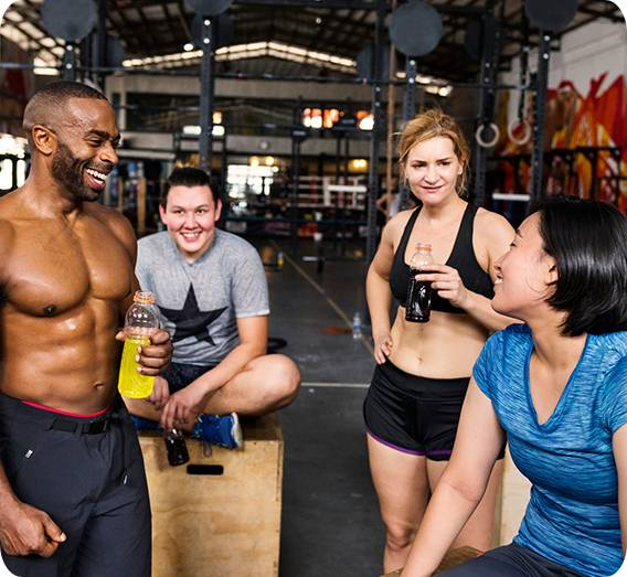 A friendly Atlanta personal trainer discussing fitness goals with his clients